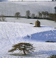 Shooting Lodge in the snow with winter trees, , Newton Wood, North Yorkshire, England - 9286-270-1