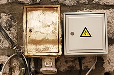 Untidy fuse and electricity boxes on a wall, Croatia, Dubrovnik, - 31040-120-1