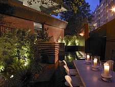Patio with table and candles at night - 12470-250-1