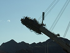 Silhouette of the new Hoover Dam bridge under construction, Nevada side - 12598-170-1