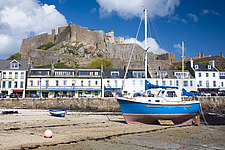 Boats on the sand in front of Gorey Castle, Gorey, Channel Islands, England - 12881-10-1