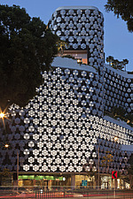 Exterior of Lluma shopping and cinema complex in Singapore by WOHA Facade lighting by realities united - 12964-60-1