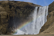 View of the valley of Skogafoss in the snow with waterfall and rainbow, Skoga, Southern Iceland - 12994-430-1