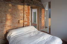 Bedroom in Zero Carbon House with exposed brick wall - 13080-270-1