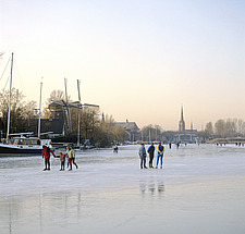 Noord-Holland, skaters on frozen Vecht river at Weesp - 13092-570-1