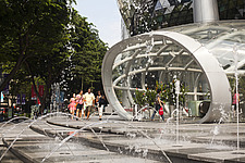 Street level entrance to MRT and ION Orchard shopping mall by Benoy and  RSP Architects Planners & Engineers - 13183-30-1