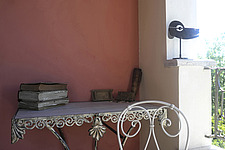 Corner of terrace with antique French furniture and objects collected on travels in europe - 13192-90-1