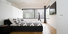 Man walks across bedroom in contrasting black and white, UP House, Hertzelia, Tel Aviv, Israel - 12472-600-1