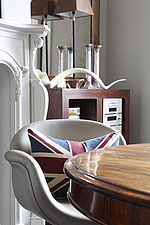 Union Jack cushion on contemporary leather dining chair at rosewood table - 13289-90-1