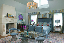 Warren platner dining chairs at foot of double bed in blue bedroom - 26029-60-1