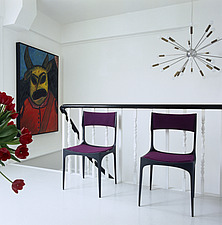 Purple chairs and artwork at top of stairs in white room - 26042-10-1