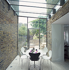 A modern dining room in a glass conservatory extension, circular table and chairs, - 26051-760-1