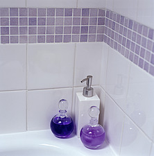 Bath oil in glass bottles on corner of bathtub - 27022-240-1