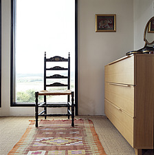 Antique ladder back chair in front of window in bedroom - 13438-180-1