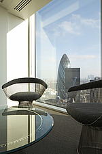 two modern Werner Platner wire modern chairs and glass topped coffee table by window with view of the Gherkin - 13533-120-1