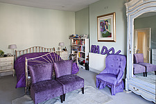 Wrought iron bed in traditional style bedroom with vibrant purple furnishings, London - 13642-300-1