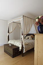 Colonial style four poster bed Bowling Hall home interior, London, UK - 13288-300-1