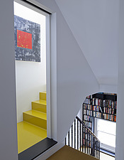 Untitled abstract painting by Elizabeth Morgan hangs on the yellow Dalsouple covered stairs leading to her converted loft workroom, built-in bookshelv... - 13940-410-1