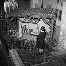 A boy admiring the Nativity or Christmas crib inside St Peter Mancroft Church, Norwich, Norfolk - 32368-480-1