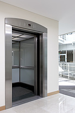 Empty lift with open doors, UK - 11581-20-1