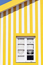 Candy striped painted beach houses, former fishermans houses in Costa Nova, Beira Litoral, Portugal - 13959-710-1