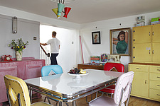 Brightly coloured American style dining room with man walking upstairs - 14200-210-1