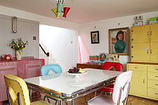 Brightly coloured American diner style room with additional pink neon striplight leaning against wall - 14200-220-1