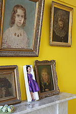 Oblique view along mantelpiece with repro Lilli doll among gold framed portraits - 14200-320-1