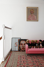 Row of Sasha dolls on miniature pink sofa on pink Persian carpet on top landing with asorted portraits on wall and floor - 14200-360-1