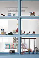 Miniature dolls' furniture arranged on glazing bars of internal window between landing and a bedroom - 14200-370-1