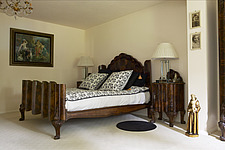 Bedroom with carved wooden bed and matching cabinet - 14596-150-1