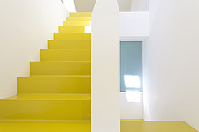 Yellow staircase in a white hallway - 14681-370-1