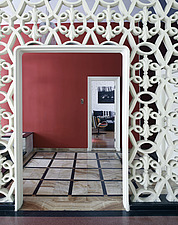 View through ornate wall screen and entrance to Brazilian residential home - 14268-220-1