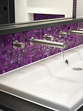 Running tap in basin with purple tiled back splash in modern shower room of Shirley Drive home, UK - 14741-330-1