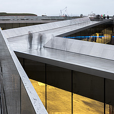 Visitors on the entrance bridge of the Danish Maritime Museum inside the dry dock at Helsingor, Denmark, by BIG Architects - 15094-280-1