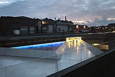 Night view of the Danish Maritime Museum inside the dry dock at Helsingor, Denmark, by BIG Architects - 15094-290-1
