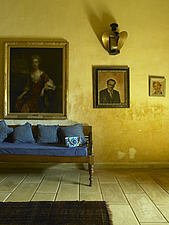 Living area with wooden sofa and portraits and ornamental light on wall in a residential home in Sri Lanka - 14282-20-1