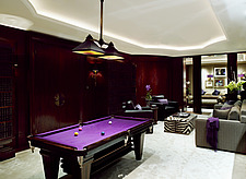 Spacious open plan room with purple pool table, armchairs and sofa in residential house, UK - 14352-160-1