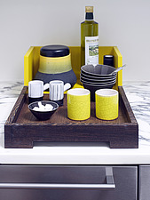 Yellow cups on tray on kitchen worktop in French home - 14470-30-1