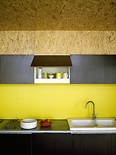 Sink set in worktop in yellow kitchen in French home - 14477-530-1