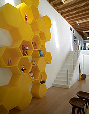 Yellow honeycomb shaped shelving unit in hallway of USA home - 14446-240-1