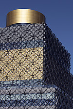 A close up of the upper floors of The Library of Birmingham, with the walls that look to be covered in mesh, and a gold band splitting two darker pane... - 15853-30-1