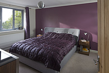 The master bedroom with a double bed in a family home - 15272-210-1