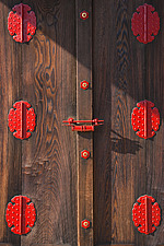 A detailed view shows the ornamental metal hardware and the beautiful grain of unpainted wooden doors at the Giyoden Hall inside Kyoto Imperial Palace... - 15522-370-1