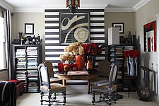 Jacobean style chairs around a table with red vases against the trademark black and white stripes  - 16124-160-1