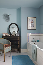 Pale blue bathroom with shells and coral and a vintage Lloyd loom chair - 16125-10-1