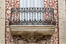 Exterior detail view of wrought iron balcony and modernist ornamentation adorning the Casa del Punt de Gantxo in old town Valencia, Spain - 16250-260-1