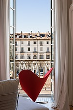 Red heart shaped chair on balcony overlooking the town of Turin - 16438-40-1