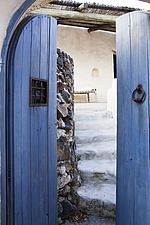 Open blue wooden arched door leading to white steps - 16440-330-1