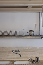 Empty shelving, sink and faucet in a domestic kitchen in Italy - 16517-20-1